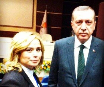 Erdoğan,Mutlu Aydemir'i tebrik etti.