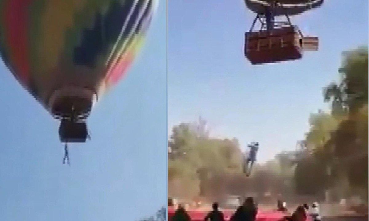 Sıcak hava balon turu sırasında sepetten bir kişi sarktı(video)